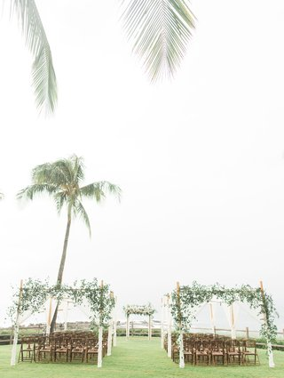 wedding-reception-montage-kapalua-bay-bamboo-chairs-green-lawn-arbor-greenery-wood-structure-outdoor