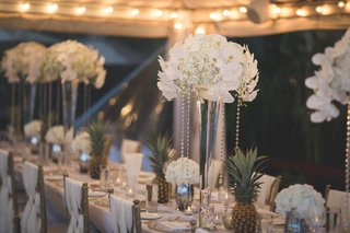 intimate-destination-wedding-in-hawaii-floral-arrangements-with-white-orchids-alternated-with-pinea