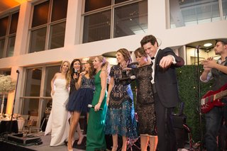 wedding-party-on-stage-mic-drop-guest-funny-wedding-museum-contemporary-art-chicago-playful