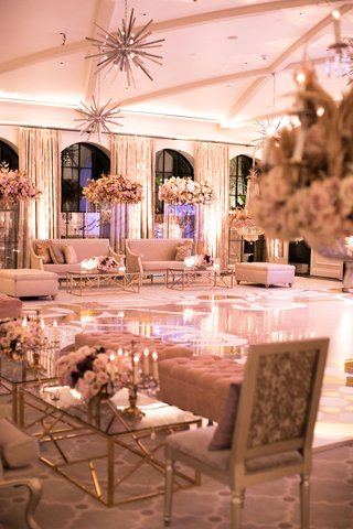 wedding-after-party-seating-areas-around-dance-floor-starburst-chandelier-high-centerpiece-gold