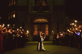 wedding-reception-send-off-sparkler-exit-bride-dipped-by-groom-kiss-outside-of-venue