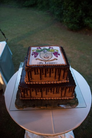 chocolate-drip-cake-grooms-cake-with-family-crest-on-top