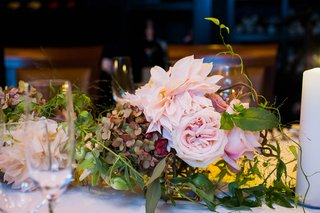 wedding-reception-table-with-pink-garden-roses-dahlias-green-hydrangeas-with-touches-of-red