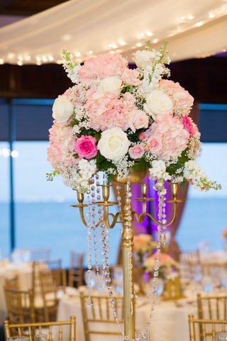 pink-and-white-flowers-atop-gilt-candelabra
