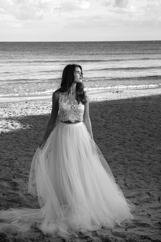 black-and-white-photo-of-two-piece-wedding-dress-with-crop-top-and-tulle-skirt