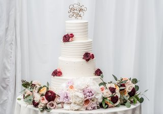 four-tiered-wedding-cake-with-fresh-marsala-and-blush-flowers-love-you-more-cake-topper