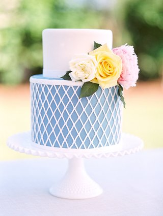 wedding-cake-just-for-cutting-blue-and-white-diamond-design-on-bottom-fresh-flowers-on-top-fondant