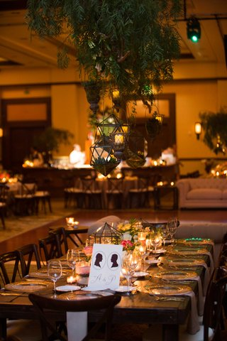 geometric-terrariums-hanging-above-tables-at-wedding-reception