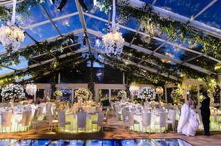 bride-and-groom-seeing-plexiglas-reception-venue-for-first-time