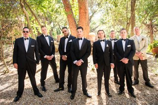 groom-in-armani-collezioni-groomsmen-pose-in-the-woods