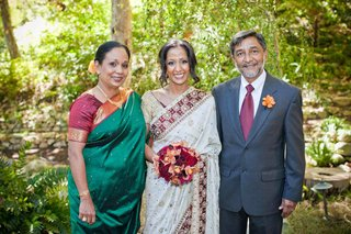 bride-in-a-white-sari-with-burgundy-and-gold-trim-with-parents