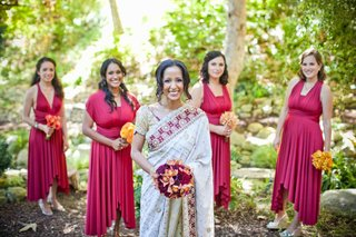 bridesmaids-in-asymmetrical-red-dresses-with-bride-in-a-white-sari