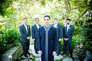 groom-in-a-navy-sherwani-with-a-silver-trim-and-groomsmen-in-dark-suits