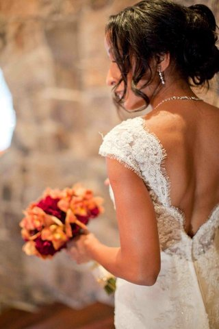 bride-in-a-lace-wedding-dress-with-a-low-v-neck-back