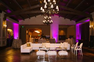 wedding-reception-lounge-area-after-party-ideas-white-faux-fur-stools-white-sectional-chairs-purple
