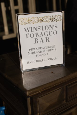 hand-rolled-cigar-station-sign-at-wedding-reception