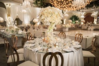 wedding-reception-white-rose-gold-round-table-mirror-top-dance-floor-chandelier-beverly-hills-hotel