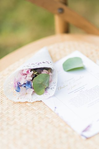 wedding-ceremony-chair-with-white-paper-cone-filled-with-pink-lavender-blue-flowers-greenery-to-toss