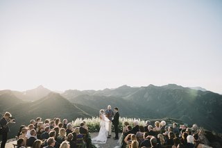 malibu-rocky-oaks-helipad-wedding-ceremony-floral-backdrop-santa-monica-mountains