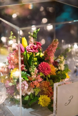 greenery-and-pink-yellow-flowers-in-lucite-box-wedding-reception-modern-decor-table-numbers