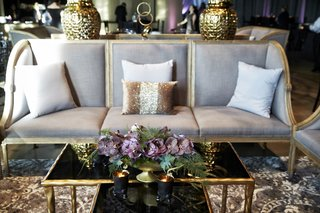 grey-lounge-furniture-with-gold-accents-purple-moth-orchids-cocktail-hour-wedding