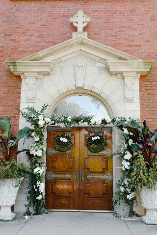 wedding-ceremony-traditional-church-service-wood-doors-wreath-greenery-garlands-white-flowers-decor