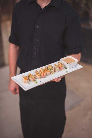 crab-summer-roll-rice-paper-daikon-cucumber-carrot-thai-basil-nuoc-chom-vinaigrette-on-tray