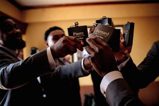 groomsmen-toasting-flasks-while-getting-ready-black-flask-with-silver-lettering-best-man-personal