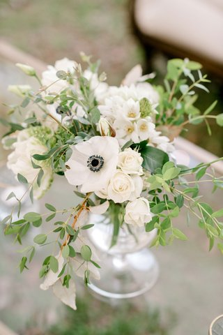 wedding-reception-cocktail-hour-flower-arrangement-green-leaves-white-anemone-white-rose-buds