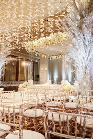 ballroom-wedding-ceremony-chicago-lucite-chair-white-butterfly-hanging-from-ceiling-clear-chuppah