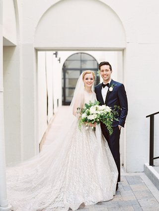 bride-in-high-neck-bateau-neckline-lazaro-wedding-dress-veil-groom-in-navy-suit-vibiana-wedding