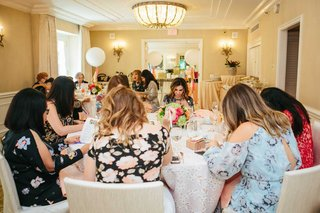 wedding-shower-bridal-shower-peninsula-beverly-hills-filling-out-multiple-choice-question-game