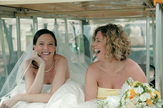 bride-and-maid-of-honor-laughing-in-golf-cart