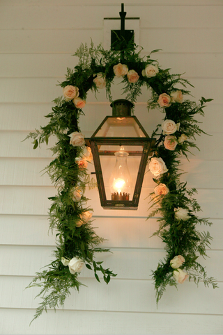 lanterns-on-wall-with-garland-of-flowers