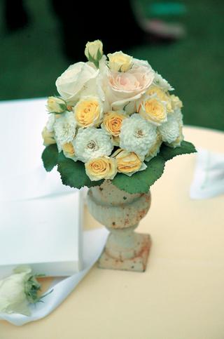 vintage-looking-vessel-holding-display-of-roses