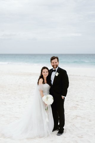 bride-in-off-shoulder-dress-with-groom-in-tuxedo-on-beach-in-the-bahamas-harbour-island-white-sand
