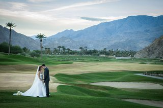 wedding-portrait-on-golf-course-in-palm-springs-area-la-quinta-resort-and-club-bride-and-groom