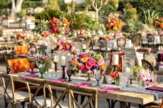 wedding-reception-wood-table-vineyard-chair-orange-head-table-pink-yellow-purple-flowers