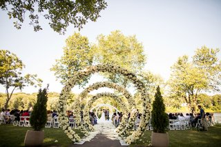 wedding-ceremony-outdoor-venue-garden-circle-arches-down-flower-petal-aisle-minnesota-wedding