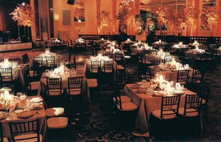 ballroom-of-square-tables-and-orange-lighting