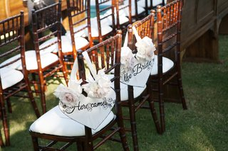 wood-ceremony-chairs-with-white-cushions-and-shabby-chic-signs