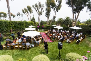 overview-of-ceremony-on-lawn-with-pink-petal-aisle
