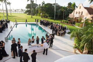 wedding-cocktail-hour-around-pool-poolside-green-lawn-view-of-ocean