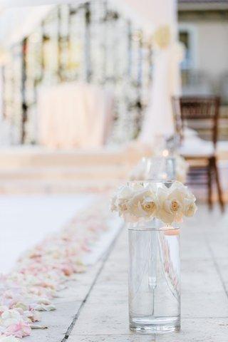 glass-vase-ivory-roses-line-aisle-blush-rose-petals