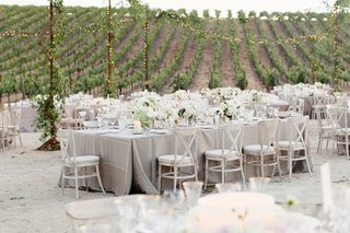 outdoor-vineyard-wedding-with-grey-linens-and-white-flowers