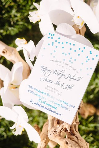 shades-of-blue-text-on-ceremony-program-polka-dots-romantic-quote
