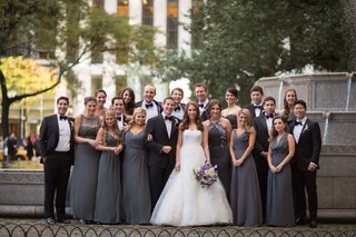 bridesmaids-in-mismatched-grey-floor-length-long-bridesmaid-dresses-groomsmen-in-tuxedos-bride-vera