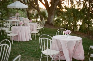 great-gatsby-themed-lawn-party-with-white-chairs