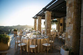 malibu-rocky-oaks-wedding-reception-overlooking-santa-monica-mountains-gold-chairs