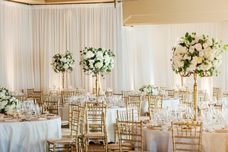 the-resort-at-pelican-hill-wedding-reception-with-gold-chiavari-chairs-tall-white-centerpieces